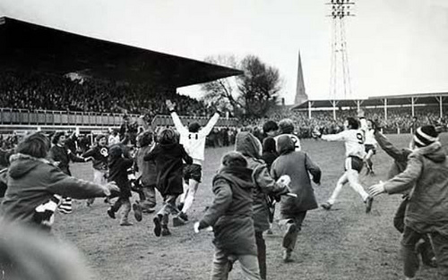 5th February 1972, FA, Cup 3rd Round Replay at Edgar Street, Hereford, Hereford United 2 v Newcastle United 1, a,e,t, Hereford fans and players rush to the No 11 Ronnie Radford who had scored a late equaliser t
